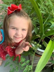 anna-little-girl-with-a-tomato-plant
