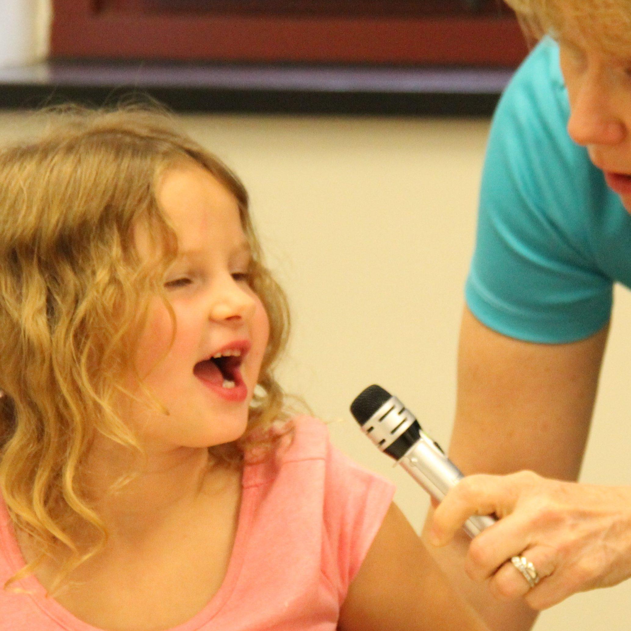 kid-talking-in-microphone